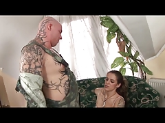 Brunette exhibitions her hairy pussy and gets fucked by soldier on couch